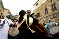 Lebanese Sufi Muslims perform during a celebration to commemorate the birth of Muslim's Prophet Muhammed in the city of Sidon, southern Lebanon, 13 January 2014. (Stringer/EPA)
