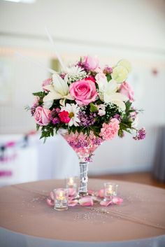 Loved the floral arrangements and placing them inside a pink martini glass was a great idea!