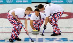 Norway's skip Thomas Ulsrud delivers the rock to sweepers Haavard Vad Petersson, left, and Christoffer Svae, right, during the men's curling match against Britain at the 2014 Winter Olympics, Sunday, Feb. 16, 2014, in Sochi, Russia. (AP Photo/Wong Maye-E)
