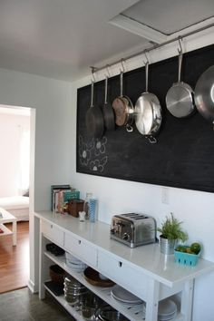 Creative Ideas To Organize Pots And Pans Storage On Your Kitchen-Railing With Hooks Near the Ceiling.