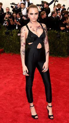 Cara Delevingne wore an edgy Carolina Herrera jumpsuit to the #MetGala. See more of the night's best looks: http://www.womensforum.com/meta-gala-2015-best-looks.html #Cara