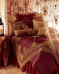 similar to the bed in the elephant, the passionate reds with gold detailing, its very bohemian indian themed