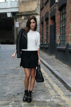 Light-colour cashmere pullover, flowy/structured black skirt, black jacket, black booties & black stocking (to alongate)