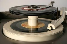 45 RPM records with a stacker ~this is how you shuffled songs back in the day,