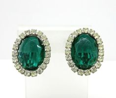 Something Special for Her! Vintage Emerald Green and White Rhinestone  Silvertone Clip-on Earrings.  A large Green Oval Rhinestone is surrounded by a halo of bright White Rhinestones, on a silvertone...