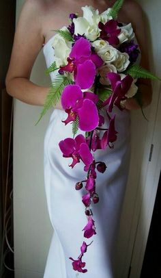Tropical Cascading Bridal Bouquet Made Of Ivory Roses, Purple Lisianthus, Sangria Clematis, Burgundy Orchid, Magenta Orchids & Emerald Green Sword Fern>>>>