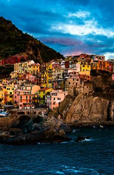 Manarola, Cinque Terre, Italy  Clinque Terre is located on the coastline of Ligurian Sea in eastern part of Italian Riviera called Riviera di Lavante. here,  you can try seafood specialities which makes this place one of the most visited destination in Italy.