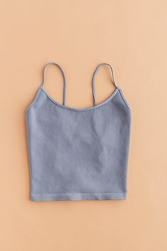 Your new favorite cami. Ultra comfy and perfect for daily wear. It's open round back with cross-strap detailing is so flattering! Stretches to fit S, M L. One Size Only Nylon Spandex Made in USA Sizing Guide: Bust: Waist: Hips: Love Street Apparel, Sustainable Companies, Retail Companies, Fit S, Daily Wear, Cami, How To Make, How To Wear, Crop Tops
