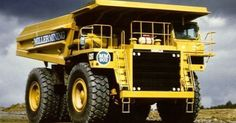 Similar Dump Trucks used to haul Iron Ore & Rock waste at our local Iron Mines. My Husband and both Sons as College Students for Summer EEs have driven these production trucks. They say it is like driving a house!! HUGE!! Photography http://ift.tt/1OtDdVa
