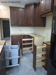 Cabinet organizers - pull out spice racks and garbage cans.