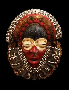 This is a Dan mask with the signature high-domed forehead, slit eyes, concave face, protruding mouth and covered in cowry shells Arte Tribal, Tribal Art, Totems, Mask Images, Bird Masks, African Sculptures, Art Populaire, Art Premier, Statues