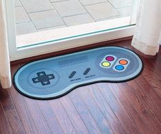 Plug and place this mat in front of your game chair, man cave, man cave entrance hole. Geek out while keeping your floors clean with this 16 bit game controller doormat.