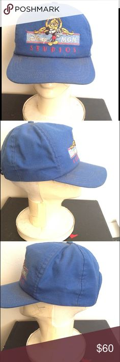 """Vintage 80's MGM STUDIOS DISNEY Mickey SNAPBACK 1987 Vintage Blue speckled WALT DISNEY MGM STUDIOS SNAP-Back Hat - What an AWESOME FIND!! 🎩👌 Hat is in good Used Vintage Condition but There are two spats of white paint near the rear , speckles and dust throughout. I will gently surface clean the hat prior to ship but, lightly to ensure preservation of its' shape and color. Some dust may resolve and some may not.🌟SOLD as is. OS Fits All. Original label attached and reads: """" Studio Tour 1987…"""