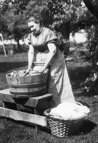 Wash day of old - Bing Images. A lot better than beating the clothes with rocks!