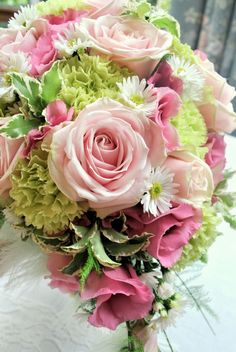 Pink, white and green bouquet of roses, lisianthus, carnations and aster - from Laurel Weddings