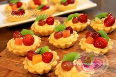 A fresh Fruit Tart recipe. This miniature tart has a custard base filling, top with fresh fruit of your choice and glaze with silky preserves. A great Christmas recipe, to prepare and to share with your friends and family. Philipinische Desserts, Filipino Desserts, Delicious Desserts, Yummy Food, Filipino Food, Fruit Custard Tart, Fresh Fruit Tart, Fruit Tarts, Dessert Recipes With Pictures