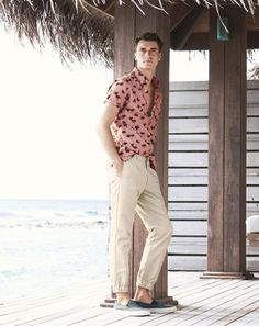 J.Crew men's short-sleeve chambray popover shirt in palm tree print, jogger pants and Sperry® for J.Crew CVO slip-on sneakers.