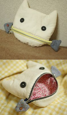 """""""A cat eating a fish""""-Pouch"""