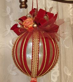 VICTORIAN PEACH & RUST ORNAMENT #13  This is a beautifully decorated gold & rust hanging ornament. It has been heavily decorated with lace and satin & velvet ribbon, cording, trim, and fringe. This ornament is great to hang from a chandelier, sconce or a Christmas tree.    Hand decorated by me and is a one of a kind design.    The ornament measures approximately 4 diameter and is 12 long including the fringe on the bottom.    If you have any questions please send me an e-mail.    Thanks for…