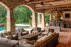 Covered Outdoor Living Spaces | ... brick and reclaimed wood is used throughout this outdoor living space
