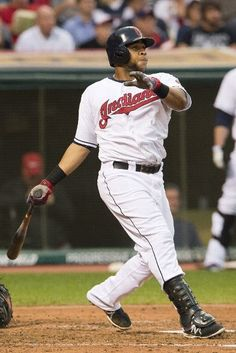 Carlos Santana #41 of the Cleveland Indians hits an RBI double during the fourth inning against the Detroit Tigers at Progressive Field on August 5, 2013 in Cleveland, Ohio. (Photo by Jason Miller/Getty Images)