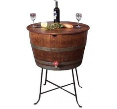 Wine Barrel Cooler made from retired wine barrels. Comes with drain spout and wrought iron legs. Use to chill wine or kegs. Also serves as a bistro wine table.
