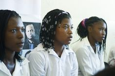 """UN Secretary-General Ban Ki-moon visited Samsão Muthemba Secondary School in Maputo, Mozambique, where he met many students and highlighted his """"UNiTE"""" campaign to end violence against women and girls. Students listening to the Secretary-General. 21 May 2013.  Maputo, Mozambique. UN Photo/Eskinder Debebe"""