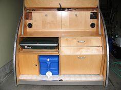 Galley kitchen built around 5-gallon water tank