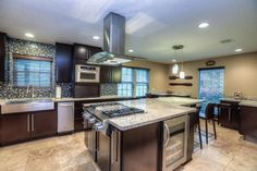 Contemporary Kitchen with complex granite tile floors, Breakfast bar, European Cabinets, U-shaped, Farmhouse sink, Flush
