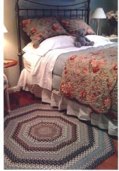 bedroom photo with braided rug