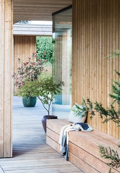 A little cozy spot - Under the covered terrace is a built-in bench that matches the house. A very practical detail.