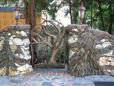 stone mason wall and custom gate  AMAZING ROCK ART. We stayed at a house in Bass Lake  and  this was their neighbors.
