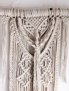 This Macrame Wall Hanging is the perfect edition to any home! It adds a lovely bohemian vibe to any space. It can be hung up against the wall or on