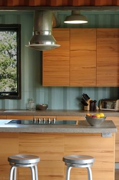 Gorgeous colors & textures!  Love this kitchen!!!  (Shipping Container House / Studio H:T)