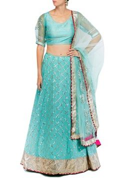 An arctic blue georgette lehenga with gota patti jaal and a crushed gota border and magenta hem. It has a can-can under layer. It comes along with a matching v-neck raw silk blouse with gold thread and pearl work abstract stripes and gota patti work organza sleeves and sheer back. It also comes along with a gota border net dupatta. Shop Now at www.carmaonlineshop.com #carma #carmaonlineshop #designer #online #gotapatti #silk #embroidery #gold #organza #devnaagri #shopnow