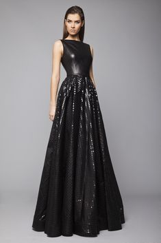 Tony Ward RTW FW15/16 l Style 12 l Black princess evening gown with bateau neckline and leather top, Muslin skirt with a square foil pattern and an open back.