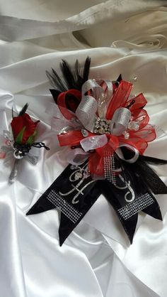 Red and black prom corsage set from Hen House Designs www.henhousedesigns.net