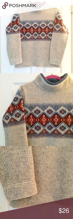"""Vintage cozy winter fleece An amazing 90's fleece with a wintery pattern across the front, back and sleeves. Thick turtleneck detail feels very warm and cozy. Slight pilling on the inside, so great to wear as an outer layer over a long sleeve or button down. Great condition. No holes or stains. Roomy and boxy fit. Offers welcome!  Measurements Shoulder to shoulder 16.5"""" Armpit to armpit 19.5"""" Shoulder to hem 24"""" Shoulder to wrist 22"""" Vintage Sweaters Cowl & Turtlenecks"""