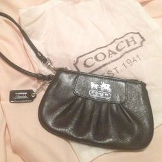 FINAL MARKDOWN ❤️ Black leather coach wristlet Coach wristlet. Small. Black leather. Dark purple inside. Received as a gift. Used maybe one time. Great condition. Coach Bags Clutches & Wristlets
