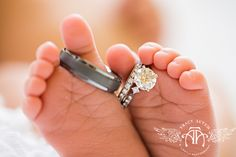 Ring detail shot during newborn baby portrait session. White, soft lighting. Photo by Lightly Photography. lightlyphoto.com