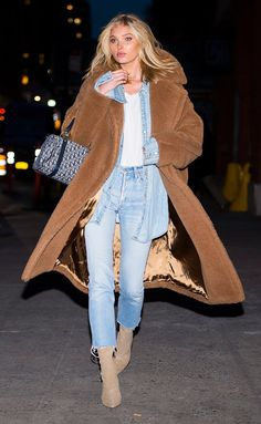 Elsa Hosk in a denim shirt, jeans, booties and teddy bear coat - click through for more winter outfit ideas