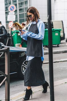A pinstripe halter top (ish?) over a blue shirt, back to a pintstripe a-line skirt and lace up peep toe ankle boots