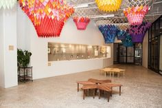 Office space lobby with colorful paper DIY chandeliers