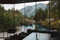 Mad tech mogul Nathan Bateman's home has gorgeous, expansive views of a lake and mountains, but an underabundance of trees, considering the film's Alaskan setting. Tall trees were imported and placed on twenty meter-high stilts to create an Alaskan vibe. #dwell #designbooks #villianhideouts #modernarchitecture