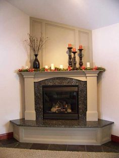 Love this look! Granite fireplace with step and mantle.