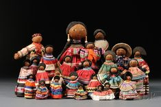 Twenty-six Seminole Indian Tourist Dolls, 20th century, various male and female coconut fiber forms with various traditional patchwork clothing, ht. to 15 in.   Estimate $300-500  Sold for $375