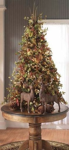 Rustic vintage old world style ole time deer woodland Christmas tree winter wonderland theme xmas Woodland Christmas, Noel Christmas, Country Christmas, Winter Christmas, Christmas Tree Top Ideas, Christmas Photos, Christmas Island, Rustic Christmas Trees, Tabletop Christmas Tree