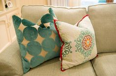 The patterns on the pillows on compliment each other.  Image from house of turquoise.