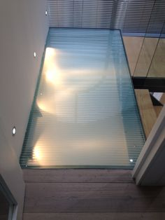 Walk-on glass staircase landing. Walking On Glass, Staircase Landing, Glass Partition, Shower Screen, Glass Bathroom, Glass Roof, Walk On, Blinds, Curtains