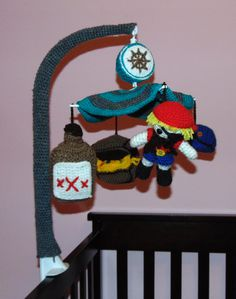 Crocheted pirate themed baby mobile. I reused my daughters flower mobile. I do not have a pattern available since I didn't go off of anyone elses pattern, I winged it.